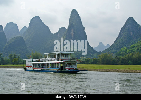 Tourist boat on Li River, Guangxi, China - Stock Photo