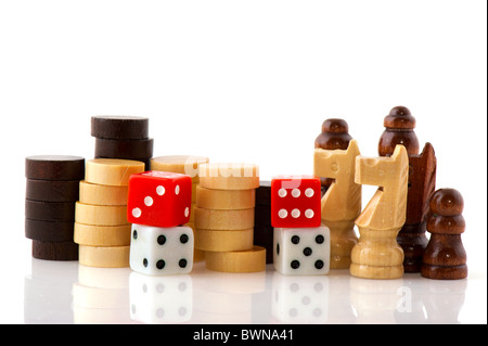 Playing games with wooden chess pawns checkers and dices isolated over white - Stock Photo