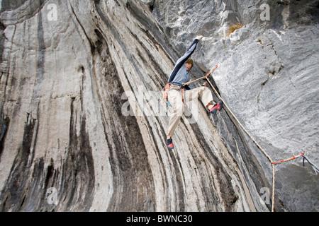 Climbing Arco Lake Garda Italy Europe September 2006 free climbing sports rock face cliff cliffs mountains - Stock Photo