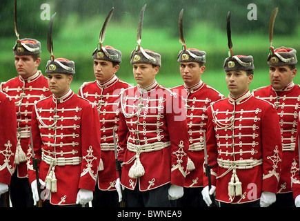 CEREMONIAL GUARD OF HONOUR, DRESSED IN RED JACKETS AND FUR HATS TRIMMED WITH A FEATHER, BULGARIA - Stock Photo