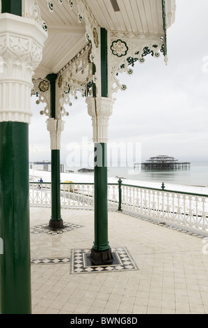 The shell of Brighton's west pier photographed from the Bedford square bandstand, known locally as the Birdcage - Stock Photo