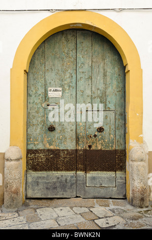 House door in the old town of Gallipoli, Puglia Italy - Stock Photo