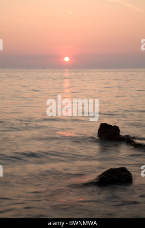 Verudela Beach, Pula, Croatia. The beautiful Istrian coastline and view from behind the Hotel Brioni at sunset. - Stock Photo