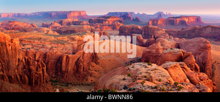 First light over Monument Valley from atop Hunt's Mesa - Stock Photo
