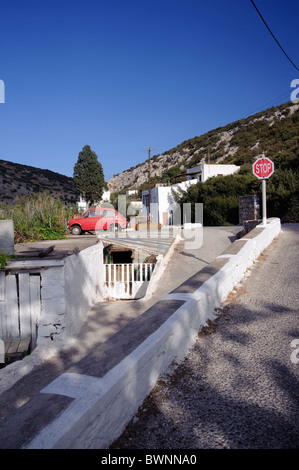 Near Galissas, on the Greek Cyclade island of Syros, an entrance to a house merges with the road. - Stock Photo