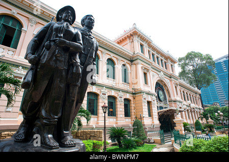 Exterior view of the General Post Office with bronze statue in the foreground. Ho Chi Minh City Vietnam - Stock Photo