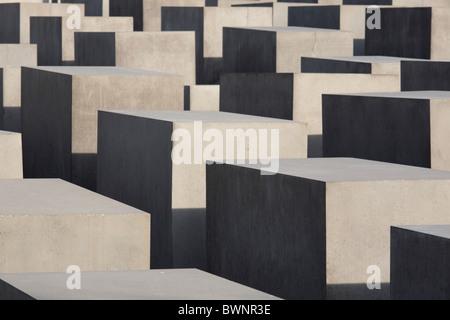 The Memorial to the Murdered Jews of Europe in Berlin, Germany; Denkmal für die ermordeten Juden Europas - Stock Photo