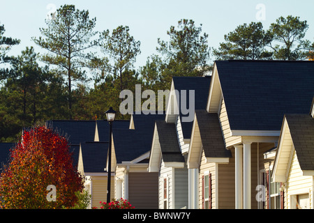 Pointed rooflines of typical middle class, southern American residential subdivision of homes that are built close - Stock Photo