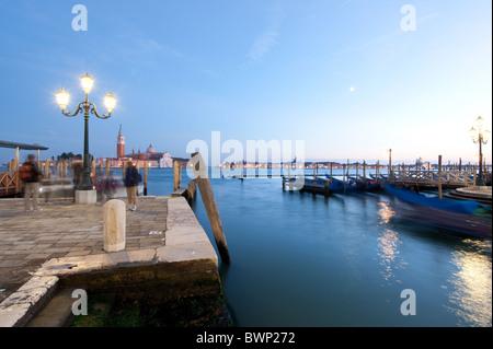 view from riva degli schiavoni to san giorgio maggiore and gondola at dusk, venice 2010 - Stock Photo