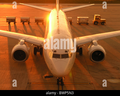 EL AL Israel Airlines Boeing 737 Jet Airplane Plane Aircraft Man Travel Traveling Dusk Dawn Zurich Airport - Stock Photo