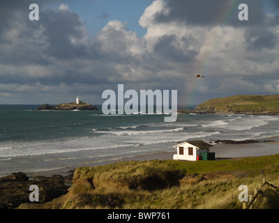 View of Godrevy Lighthouse with rainbow and kestrel - Stock Photo