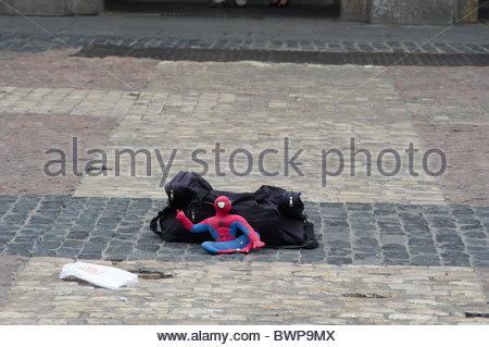 Plaza Mayor in Madrid street performer dressed as Spiderman - Stock Photo