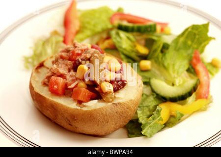 Jacket Potato with Tuna and Mixed Bean Salad - Stock Photo