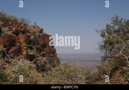 Namibia Africa Waterberg Summer 2007 Africa landscape nature mountain mountains rock man one person standi - Stock Photo