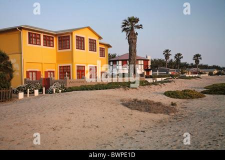 Namibia Africa Swakopmund Summer 2007 Africa houses sandy desert sand palm desert town settlement city - Stock Photo