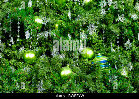 Decorated Christmas tree abstract green background - Stock Photo