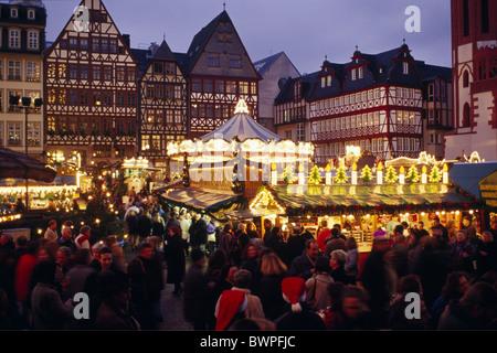 Germany Europe Frankfurt on Main Christmas market Romer Hessen dusk at night evening illuminated illuminatio - Stock Photo