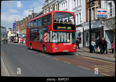A red London double bus operated by Metrobus, part of the Go-Ahead group, travels along Bromley High Street - Stock Photo