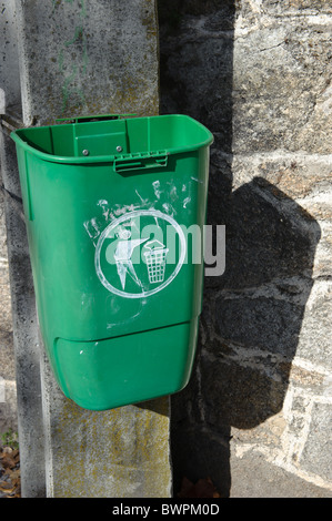 Vandalized public trash can in Portugal - Stock Photo