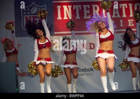 San Francisco 49er Goldrush cheerleaders perform during the NFL rally at Trafalgar Square, London on October 30, - Stock Photo