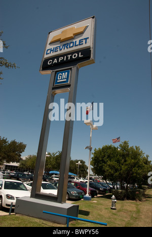 Large Capital Chevrolet sign on standards shows Chevy and General Motors logos in front of dealership in Austin, - Stock Photo