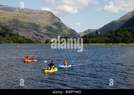 tourist in canoes on lake padarn in llanberis north wales - Stock Photo