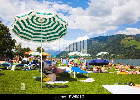 Zell Am See Lake in Austria. View of the lido on the lake shore. - Stock Photo