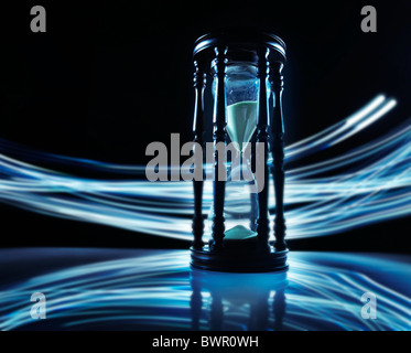 Hourglass with blue streaks rushing by - Stock Photo