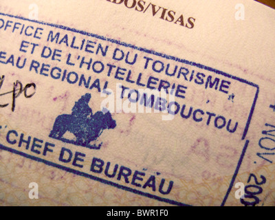 Passport with a rubber stamp from the Tourist Office at  Timbuktu. Mali - Stock Photo