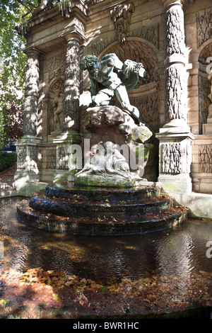 Polyphemus surprising Acis & Galatea sculpture by Auguste Ottin is focal point of Medici Fountain Luxembourg Gardens - Stock Photo