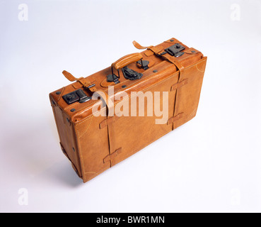 suitcase made of leather air travel air trip brown case departure from above international one studio vacat - Stock Photo