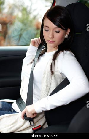 Girl wearing seatbelt - Stock Photo
