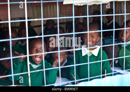 Schoolchildren from Mathare slums in a classroom at Maji Mazuri Centre and School, Nairobi, Kenya - Stock Photo