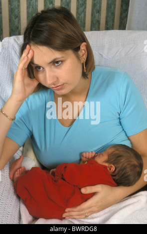 young mum suffering from post natal depression - Stock Photo