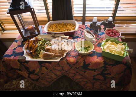 American holiday meal, table setting, self serve buffet style, Turkey, mashed potatoes, stuffing, gravy, cranberry - Stock Photo