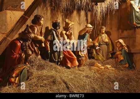 Christmas Nativity scene Religion Crib Manger Joseph Mary Caspar Melchior Balthasar shepherds Hay Figures - Stock Photo