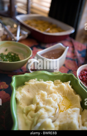 Holiday side dishes on a table: mashed potatoes and gravy, United States - Stock Photo
