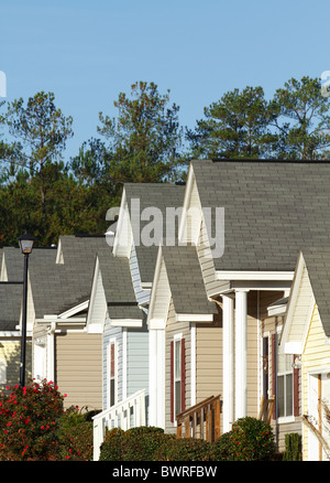 Typical modern middle-class subdivision houses in a housing development in the USA in the Fall season. - Stock Photo