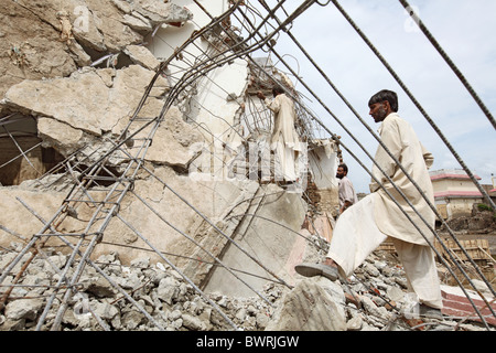Destroyed house on the bank of Swat River, Mingora, Pakistan - Stock Photo