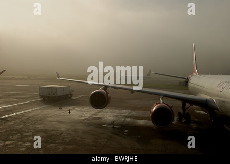 Airplanes in fog at Heathrow Airport, London, UK. - Stock Photo
