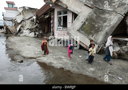 Destroyed house on the bank of Swat River, Mingora, Pakistan - Stock Photo