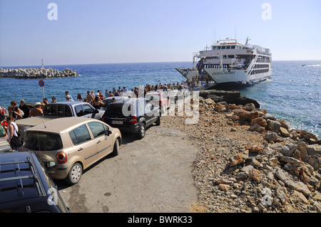 People leaving ferry in of Chora Sfakion, Crete - Stock Photo