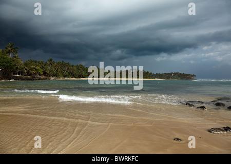 Beach and gathering storm. Mirirssa, Sri Lanka - Stock Photo