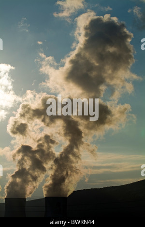 Smoke emitting from cooling towers of Tricastin Nuclear Power Plant, Drome, France. - Stock Photo