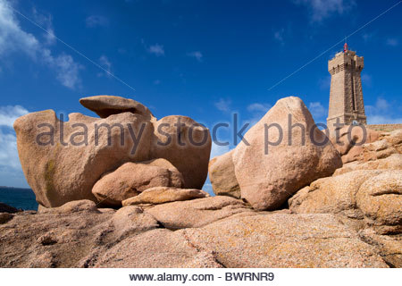Ploumanac'h lighthouse and strange rock formations on the pink granite coast in Brittany - France - Stock Photo