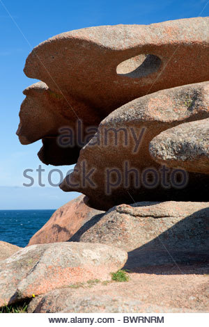 Rock formation at the pink granite coast in Brittany - Presqu'île Renote at Tregastel (near Perros Guirec) - France - Stock Photo