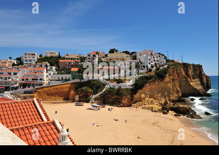 The wide beach and town of Carvoeiro on the Algarve in Portugal. - Stock Photo