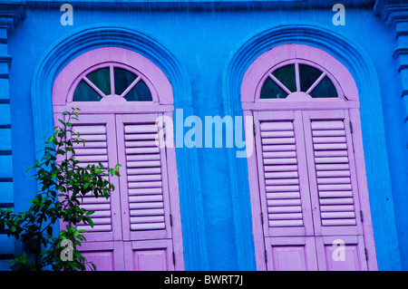 windows with shutters on second story apartment in Singapore - Stock Photo