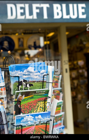 Postcards on sale outside a shop in Delft in the Netherlands - Stock Photo