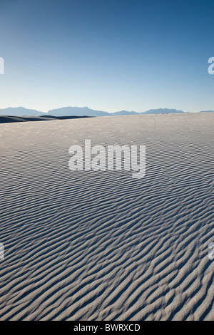Pattern formed by the wind in the white gypsum sand dunes of White Sands National Monument in Alamogordo, New Mexico, - Stock Photo
